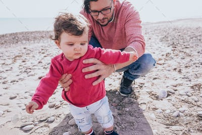 Young dad have a great day at the beach with his dauther