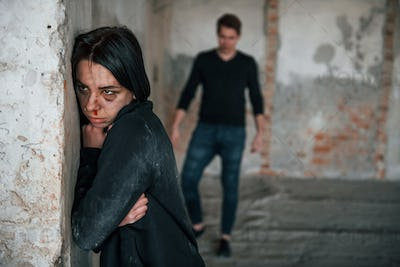 Kidnapped woman is threatened by man in abandoned building
