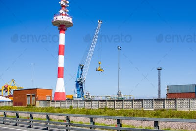 Crane in the cargo port against the blue sky