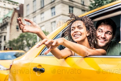 Couple on a taxi in Manhattan