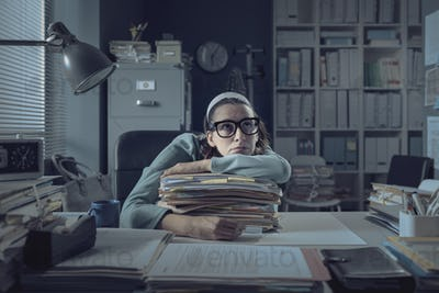 Frustrated office worker leaning on the desk