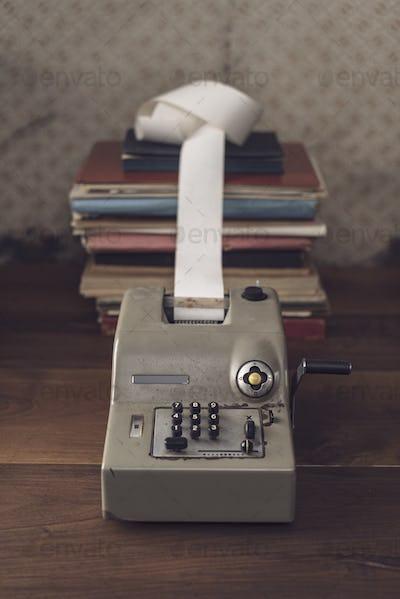 Vintage calculator on the accountant desk