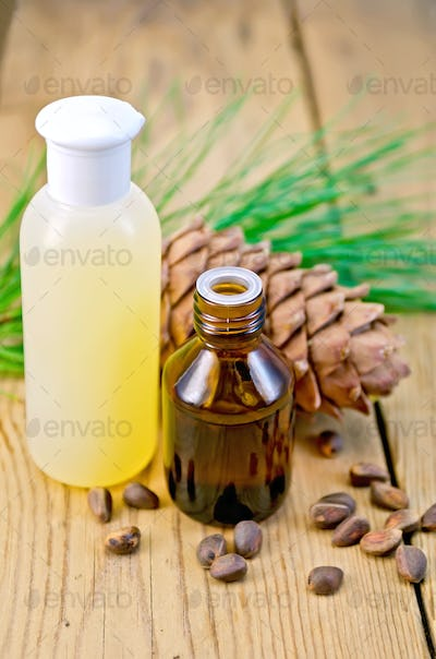 Oil and lotion with cedar cone and nuts on board