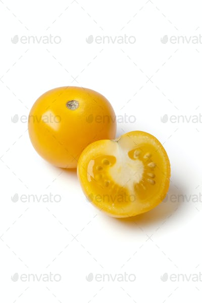 Whole and half yellow tomato