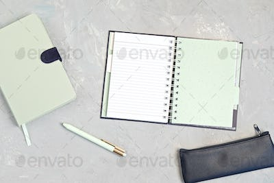 Styled minimal desktop mockup with organic color notepads