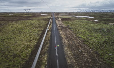 Couple of skateboarders on the icelandic roads