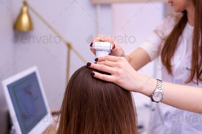 Hair examination in the clinic.