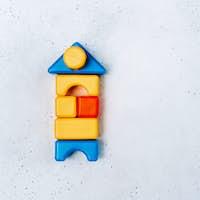 Children's blocks on a white concrete background