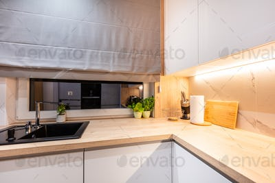 Kitchen in a modern small apartment for rent.