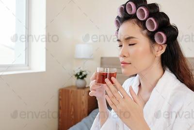 Woman enjoying herbal tea