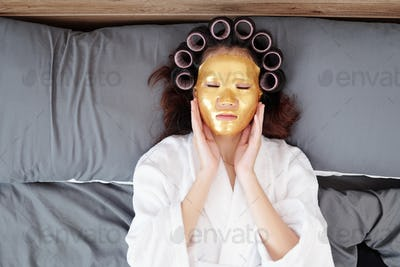 Woman relaxing with sheet mask on