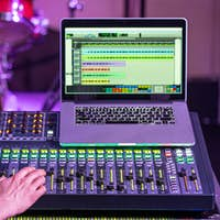Digital mixer in a recording Studio , with a computer for recording music.