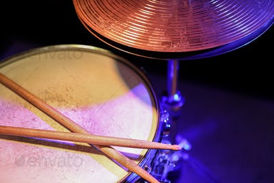 Drum sticks on a snare drum close up top view.