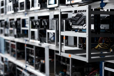 close-up shot of graphic cards on shelves at cryptocurrency mining farm