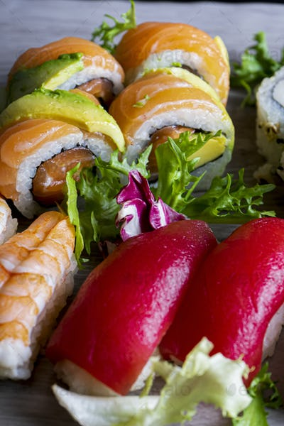 Close up of various delicious sushi on the decorated plate.Vertical Image