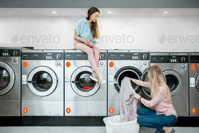 Women in the self-service laundry