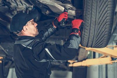 Automotive Mechanic Replacing Car Suspension Elements