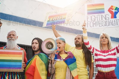 Gay and transgender people protest at pride event outdoor - Main focus on drag queen face