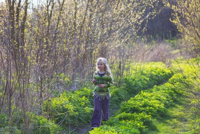 Girl on spring meadow
