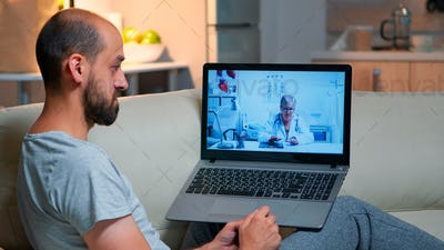 Caucasian male chatting with physician doctor during online telemedicine consultation