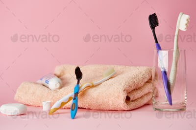 Oral care products, pink background, toothcare