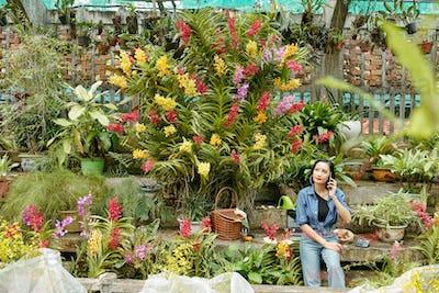 Pretty woman working in greenhouse