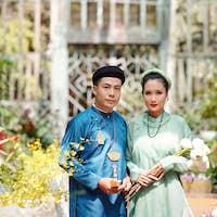 Vietnamese couple with lotus flowers