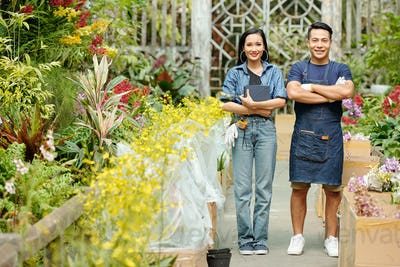 Couple working in greenhouse