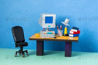 Retro office interior workplace. Stylish black leather office chair.