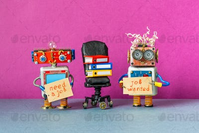 Unemployed robots with a cardboard placards handwritten text Job Wanted and Need a job.