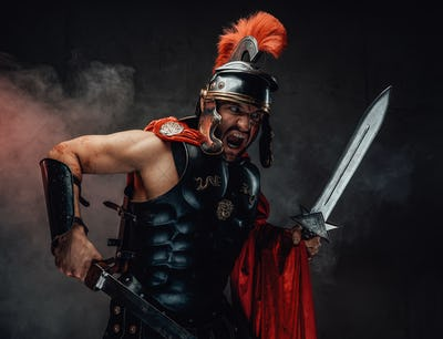 Screaming and savage roman warrior with swords and armour