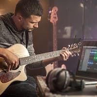 Professional musician recording in studio.