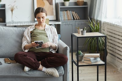 Pregnant woman sitting at home
