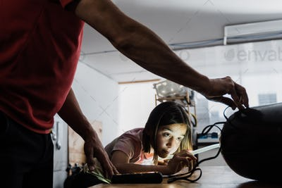Father and daughter working at diving workshop center - Diver tank visual inspection