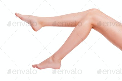 Perfect legs. Close-up of young woman with long legs isolated on white