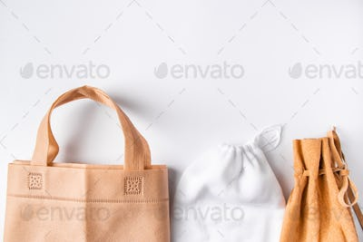 Zero waste concept. Set recycled home accessories - eco-friendly bags and wooden supplies