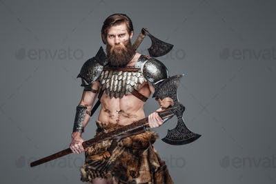 Martial muscular man from netherlands posing with an axe