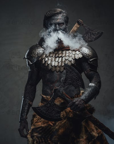 Muscular and scary warrior exhaling smoke and holding a huge axe