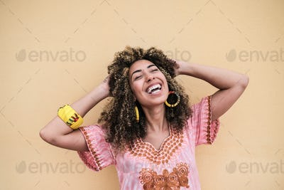 Cheerful african woman wearing traditional dress - Concept of happiness