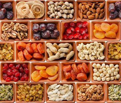 Seamless flat lay food background of dehydrated fruits, seeds and nuts on white