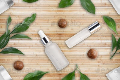 Tileable seamless flat lay background of bottles with macadamia nut cosmetics