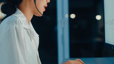 Asia young call center agent or customer support service executive using computer working.