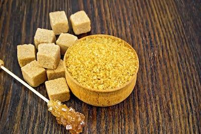 Sugar brown in bowl on wooden board
