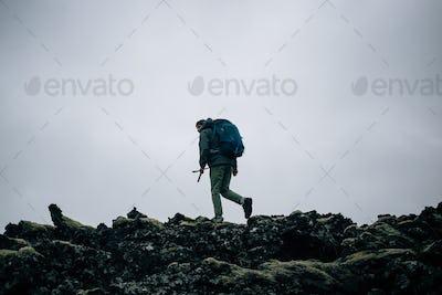 Adventure man walk in icelandic landscape alone