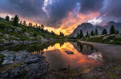 Dark and gloomy sunset at the mountain lake