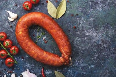 Smoked sausage circle on blue kitchen table