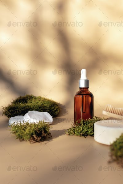 Healthcare concept with bath accessories on beige background with green moss