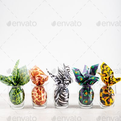 Easter eggs wrapped up in animal print paper