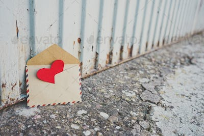 Little red hearts inside of an old envelope