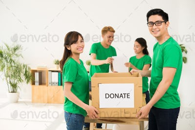 Young people with donation box